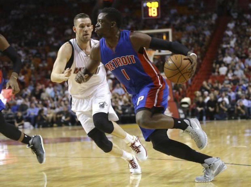 Photo - Detroit Pistons' Reggie Jackson (1) drives to the basket as Miami Heat's Beno Udrih defends during the first half of an NBA basketball game, Tuesday, Dec. 22, 2015, in Miami. (AP Photo/Lynne Sladky)