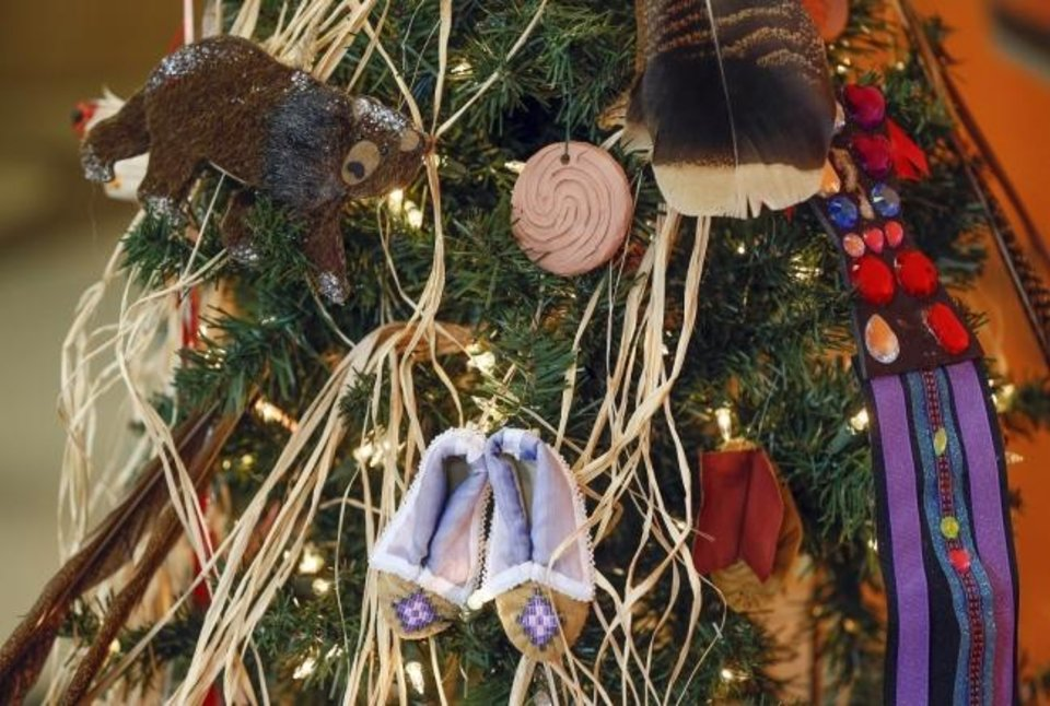 Photo -  Ornaments adorn the Caddo (Hasinai) Nation Christmas Tree at the 2019 Red Earth Treefest at the OSU-OKC Student Center in Oklahoma City. [The Oklahoman Archives]