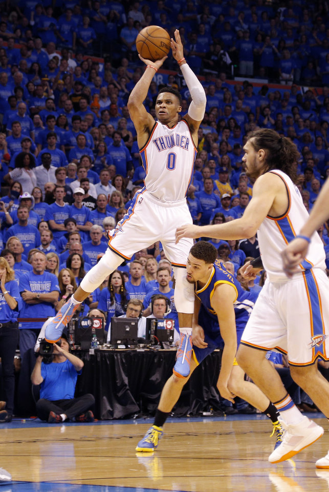 Photo - Oklahoma City's Russell Westbrook shoots as he is fouled by Golden State's Klay Thompson during Game 6 of the Western Conference finals in the NBA playoffs at Chesapeake Energy Arena in Oklahoma City last month. (Photo by Sarah Phipps, The Oklahoman)