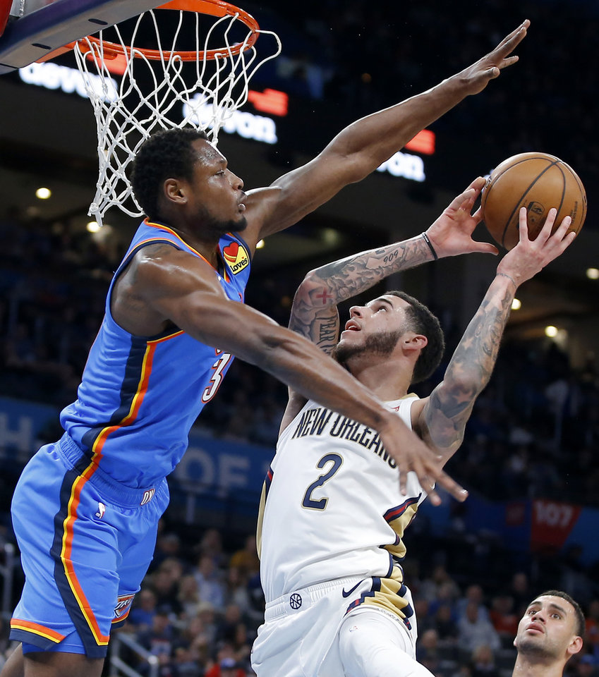 Photo - Oklahoma City's Deonte Burton (30) defends New Orleans' Lonzo Ball (2) during an NBA basketball game between the Oklahoma City Thunder and the New Orleans Pelicans at Chesapeake Energy Arena in Oklahoma City, Saturday, Nov. 2, 2019. Oklahoma City won 115-104. [Bryan Terry/The Oklahoman]
