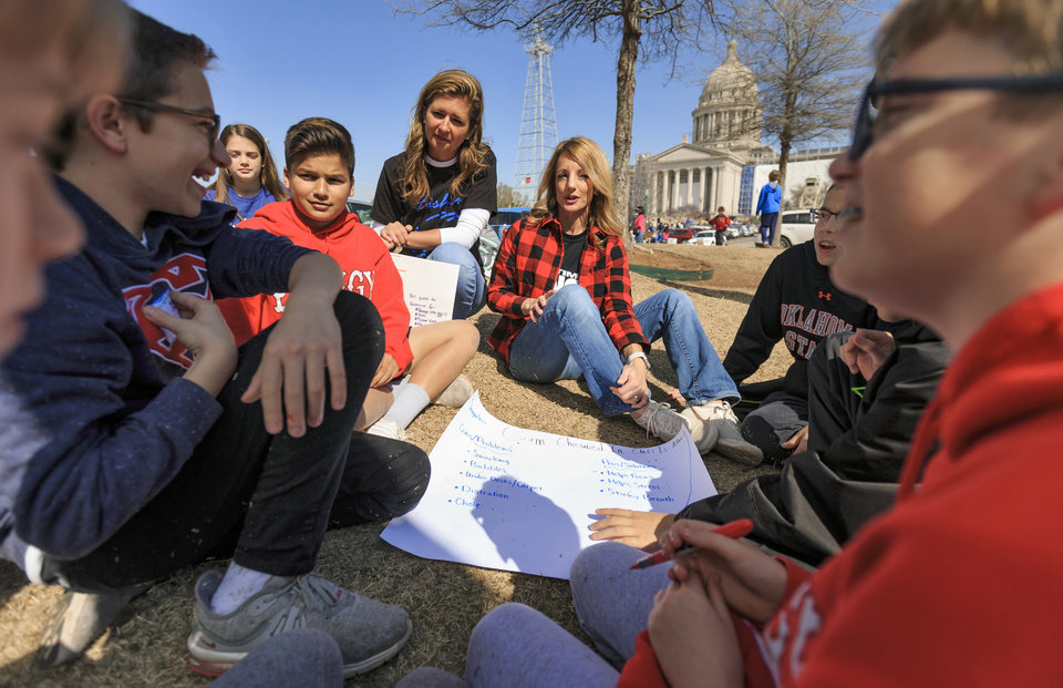 Photo - Fisher Elementary teachers Cheri Green, left, and Kelley Gappa conduct a social studies class with their students on the lawn outside the Capitol during the ninth day of a walkout by Oklahoma teachers at the state Capitol in Oklahoma City, Okla. on Tuesday, April 10, 2018.   Photo by Chris Landsberger, The Oklahoman