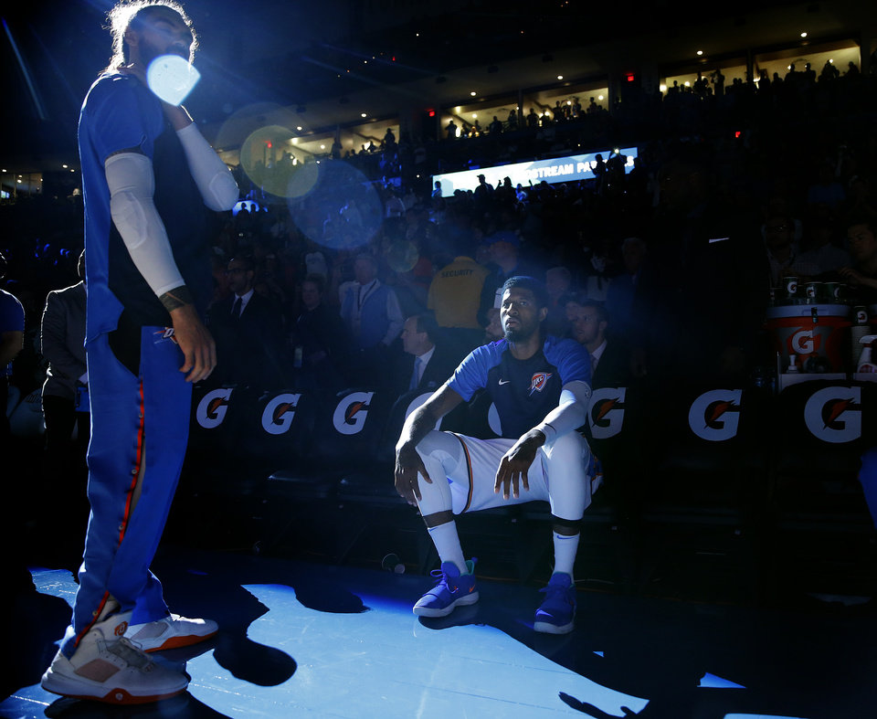 Photo - Oklahoma City's Paul George (13) waits to be introduce before  a NBA preseason game between the Oklahoma City Thunder and Milwaukee Bucks at Chesapeake Energy Arena in Oklahoma City,  Tuesday, Oct. 9, 2018. Iowa State won 48-42. Photo by Sarah Phipps, The Oklahoman