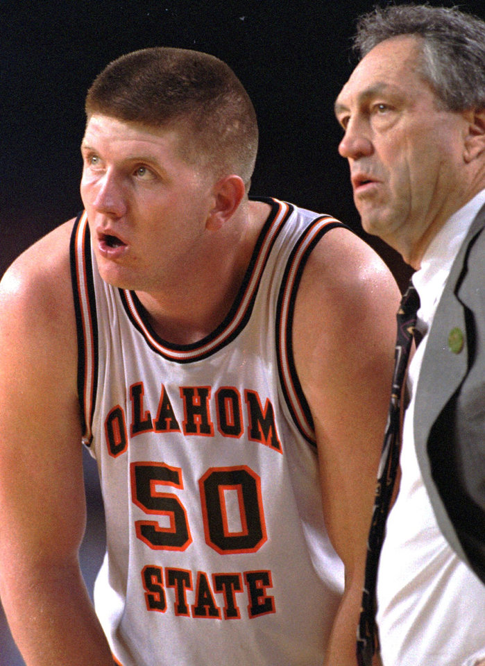 973bd1b2e OSU center Bryant Reeves listen to coach Eddie Sutton during the second  half of their game
