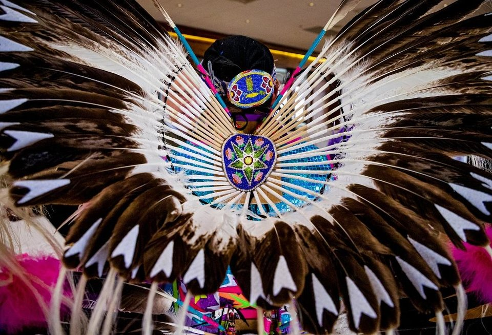 Photo - ative American fancy dancer Cecil Gray appears during a Red Earth press conference at the Petroleum Club in Oklahoma City, Okla. on Monday, Feb. 17, 2020. The news conference announced a new location for the annual Red Earth Festival, a new fall event to mark Oklahoma City's Indigenous Peoples Day and the launch of arts events around the state. [Chris Landsberger/The Oklahoman]