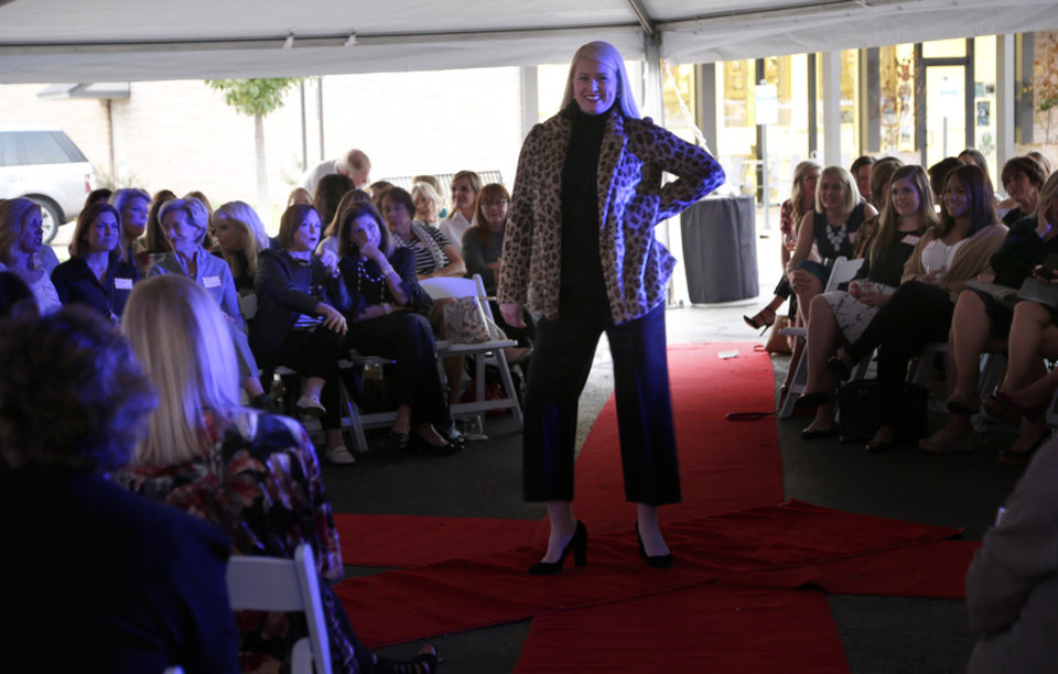 Photo -  Fall's latest trends are highlighted during Chi Omega sorority's Fashion with a Passion at CK & Co. in Nichols Hills Plaza. [PHOTO BY SARAH PHIPPS, THE OKLAHOMAN]