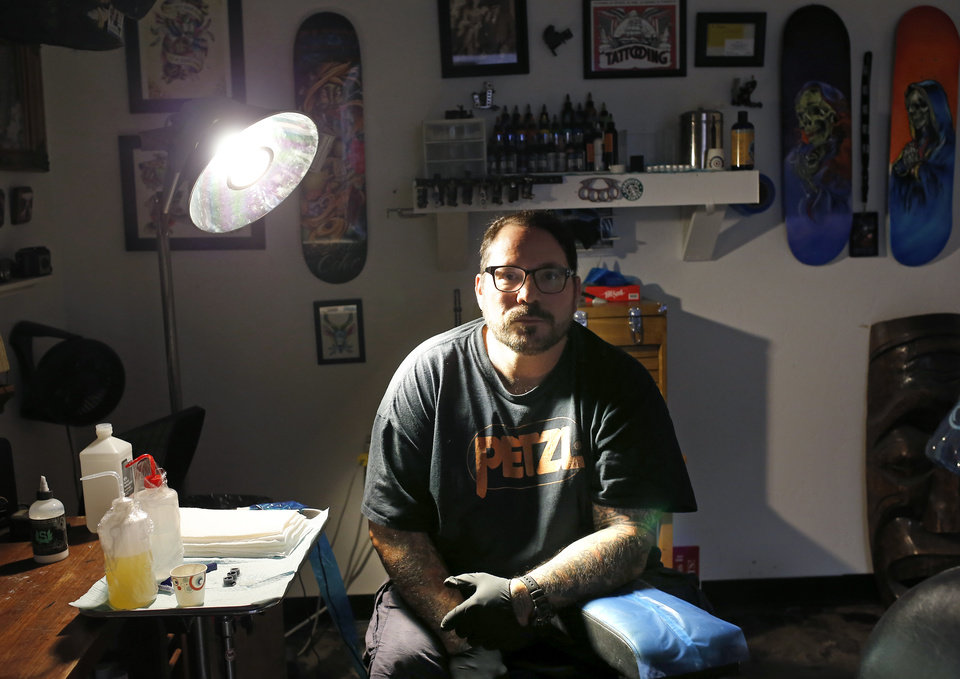 Photo - Thomas Deaton poses for a photograph at Addiction Tattoo Studio in Midwest City, Tuesday, June 25, 2019. [Sarah Phipps/The Oklahoman]