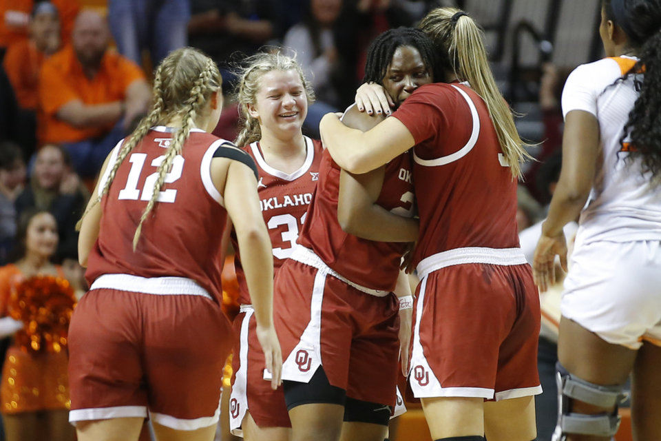 Photo - Oklahoma's Madi Williams (25) hugs Mandy Simpson (3) after making a basket to put Oklahoma up i the final seconds of a women's Bedlam college basketball game between the Oklahoma State University Cowgirls (OSU) and the University of Oklahoma Sooners (OU) at Gallagher-Iba Arena in Stillwater, Okla., Wednesday, Jan. 8, 2020. [Bryan Terry/The Oklahoman]