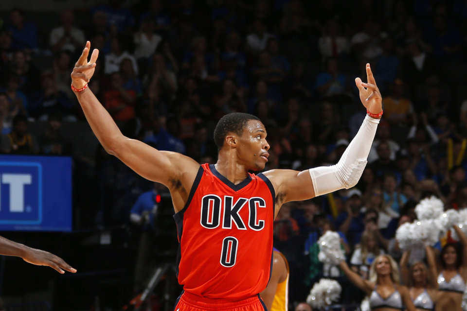 Photo - Oklahoma City's Russell Westbrook (0) celebrates with fans during the NBA game between the Oklahoma City Thunder and Los Angeles Lakers at the Chesapeake Energy Arena, Sunday, Oct. 30, 2016. Photo by Sarah Phipps, The Oklahoman