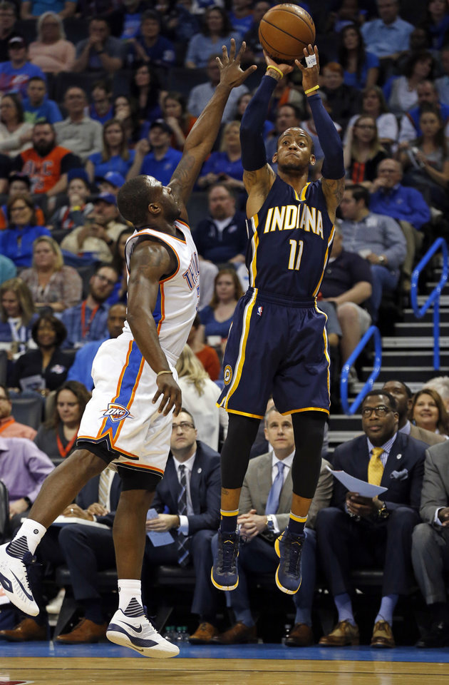 Photo - Indiana's Monta Ellis (11) shoots guarded by Oklahoma City Thunder's Dion Waiters (3) in the first half of an NBA basketball game where the Oklahoma City Thunder play the Indiana Pacers at the Chesapeake Energy Arena in Oklahoma City, on Feb. 19, 2016.  Photo by Steve Sisney The Oklahoman