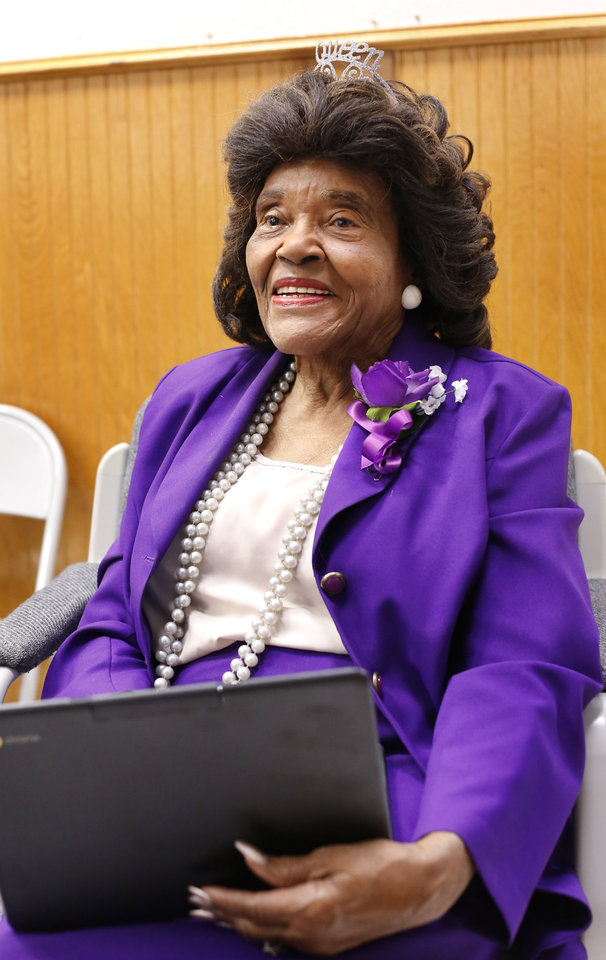Photo - Thelma Parks smiles as she listens to various speeches extolling her skills and contributions to the quality of education in the public schools in Oklahoma City for several decades during an assembly where Parks was honored. The school that bears her name, Thelma Parks Elementary School, is celebrating its 20th anniversary with special guests that included Parks,  a former teacher and school board member, and Thurman White Jr., a 2017 Foundation for Oklahoma City Public Schools Wall of Fame inductee who had Parks as a teacher. The event was held  in the school's auditorium on Thursday, Nov. 2, 2017.  Photo by Jim Beckel, The Oklahoman