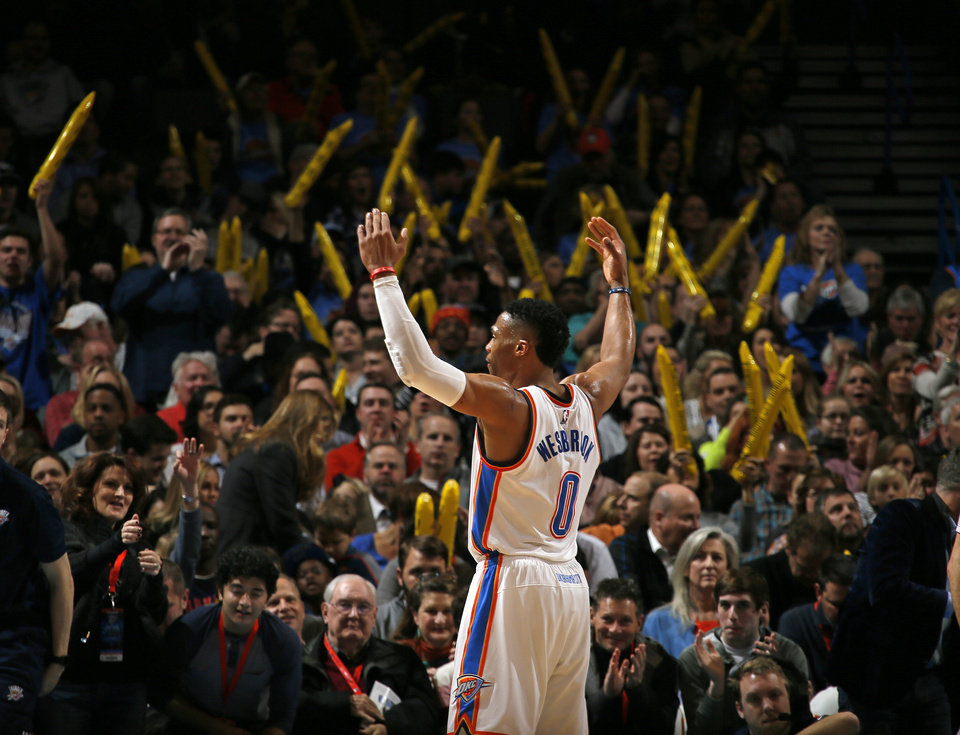 Photo - Oklahoma City's Russell Westbrook celebrates in front of a crowd during an NBA basketball game between the Oklahoma City Thunder and the Orlando Magic at Chesapeake Energy Arena in Oklahoma City, Wednesday, Feb. 3, 2016. Photo by Bryan Terry, The Oklahoman