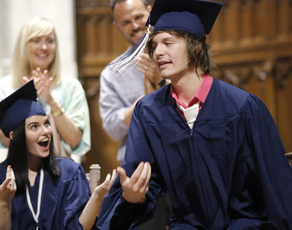 Photo - Savanna claps for Joshua as he reacts after his name is called for his introduction during the Teen Recovery Solutions (TRS) at Mission Academy high school graduation ceremony at St. Paul's Episcopal Cathedral, 127 NW 7th, in Oklahoma City, Thursday, May 26, 2016. Photo by Doug Hoke, The Oklahoman