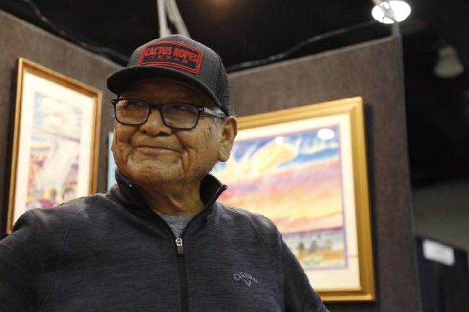 Photo -  Baje Whitehorne Sr. talks about his artwork Friday on the first day of the 2019 Red Earth Festival at the Cox Convention Center in Oklahoma City.  [Paxson Haws/The Oklahoman]