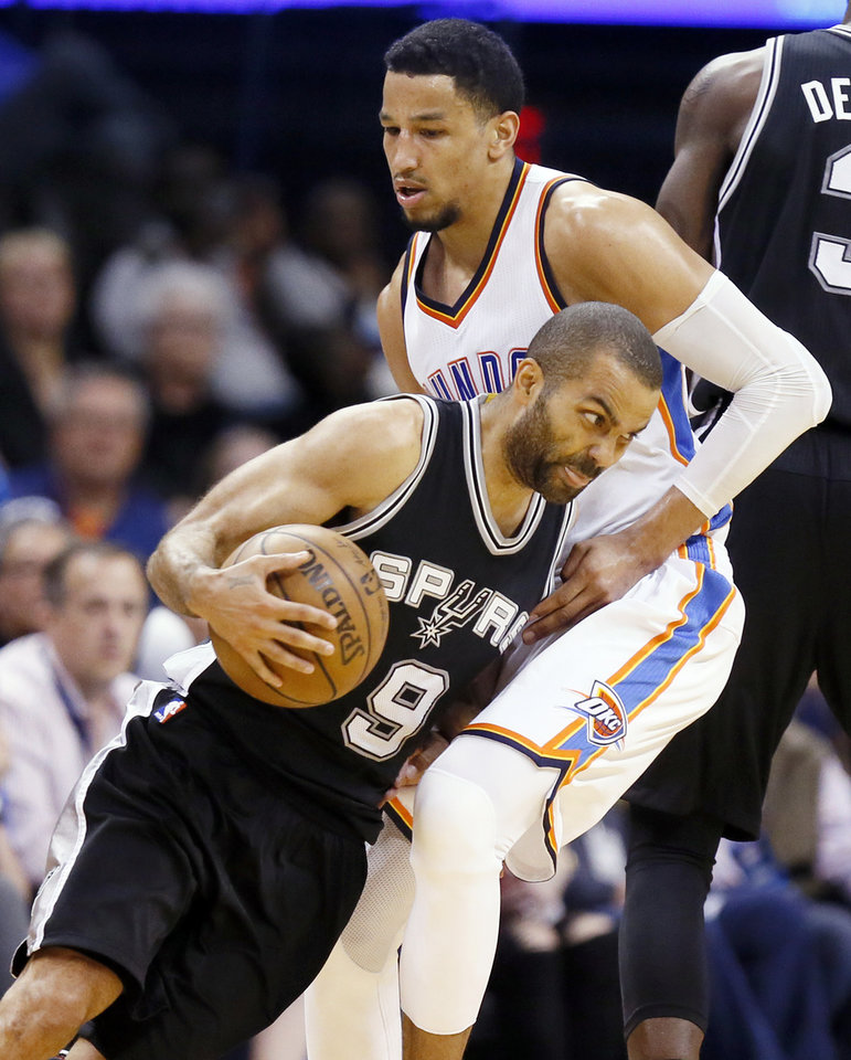 Photo - Oklahoma City's Andre Roberson (21) defends San Antonio's Tony Parker (9) during an NBA basketball game between the Oklahoma City Thunder and San Antonio Spurs at Chesapeake Energy Arena in Oklahoma City, Friday, March 31, 2017. San Antonio won 100-95. Photo by Nate Billings, The Oklahoman