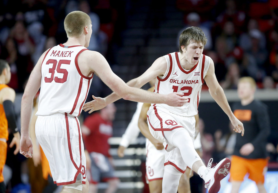 Photo - Oklahoma's Austin Reaves (12) celebrates with Brady Manek (35) during a Bedlam college basketball game between the University Oklahoma Sooners (OU) and the Oklahoma State Cowboys (OSU) at the Lloyd Noble Center in Norman, Okla., Saturday, Feb. 1, 2020. Oklahoma won 82-69. [Bryan Terry/The Oklahoman]