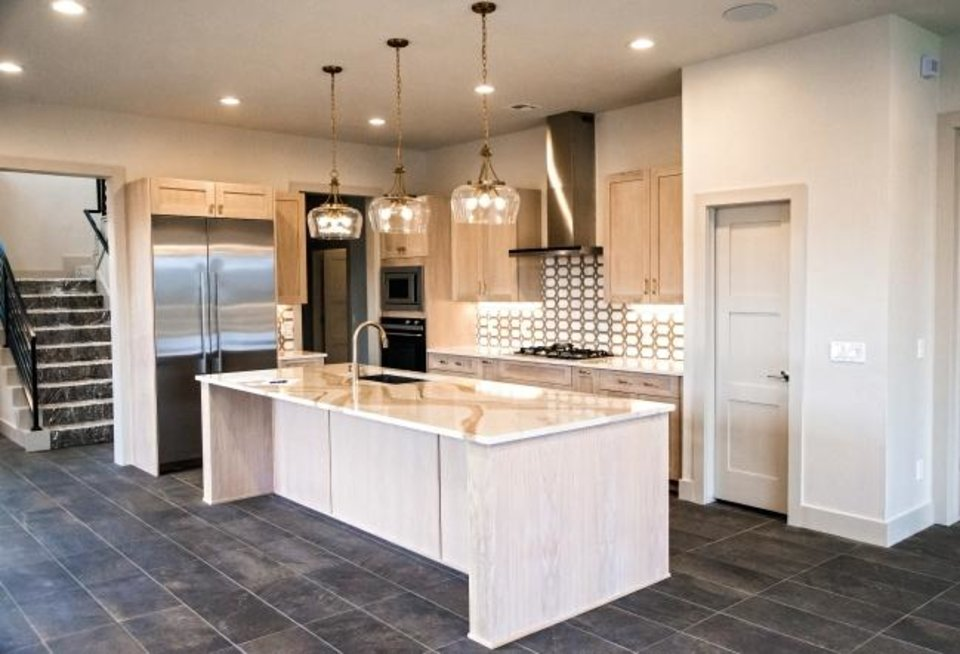 Photo -  The kitchen of the model home at 850 NW 72. [CHRIS LANDSBERGER/THE OKLAHOMAN]