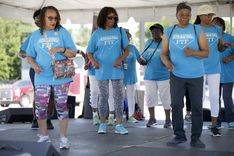 Photo - The MetroFit line dancers perform during the oNE OKC annual street festival hosted Northeast OKC Renaissance Inc. in Oklahoma City, Saturday, June 8, 2019. [Bryan Terry/The Oklahoman]