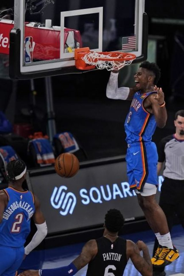 Photo -  Thunder guard Hamidou Diallo completes an alley-oop during the second half of a 101-89 win against the Knicks on Friday at Madison Square Garden in New York. [AP Photo/Seth Wenig, Pool]