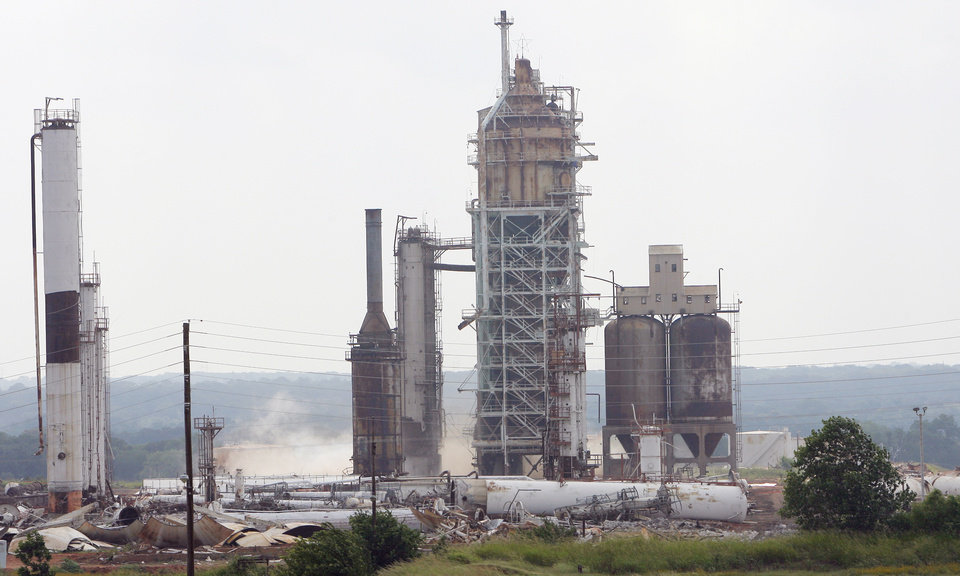 Photo -  Demolition takes place in 2006 at the old refinery north of Comanche, years after it had been shut down.
