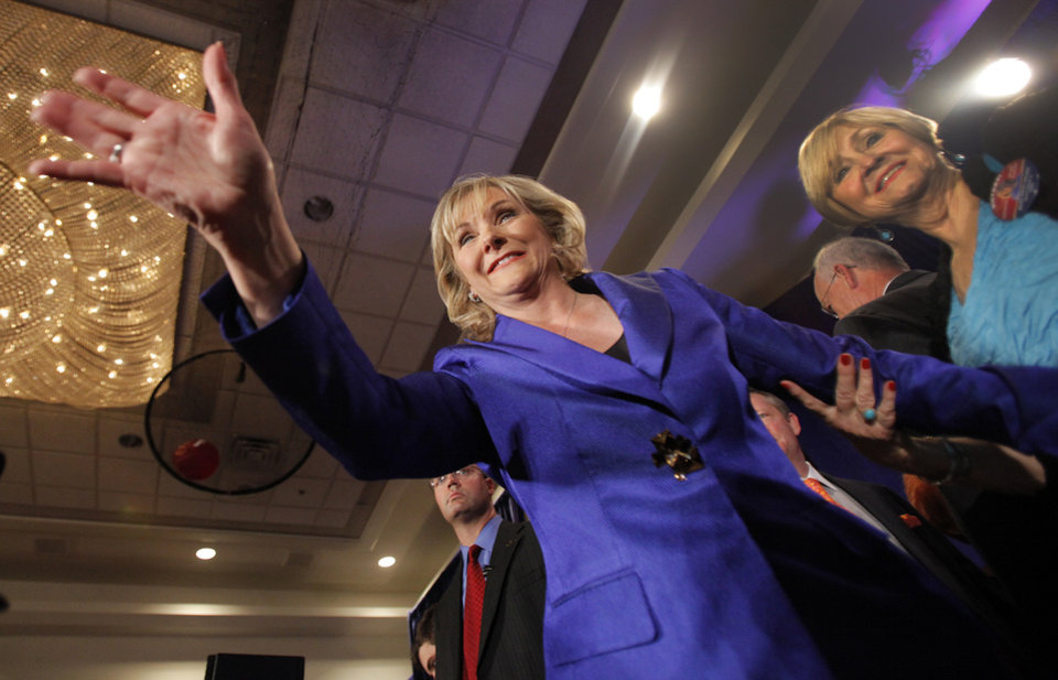 Photo - Governor elect Mary Fallin waves to supporters while on stage at the republican Watch Party at the Marriott on Tuesday, Nov. 2, 2010, in Oklahoma City, Okla. Fallin won the election over Jari Askins.   Photo by Chris Landsberger, The Oklahoman