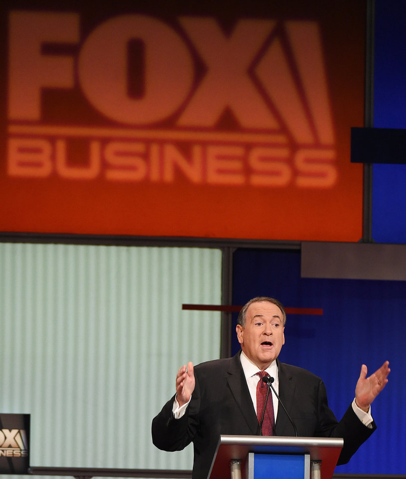 Photo - Republican presidential candidate, former Arkansas Gov. Mike Huckabee speaks during the Fox Business Network Republican presidential debate at the North Charleston Coliseum, Thursday, Jan. 14, 2016, in North Charleston, S.C. (AP Photo/Rainier Ehrhardt)