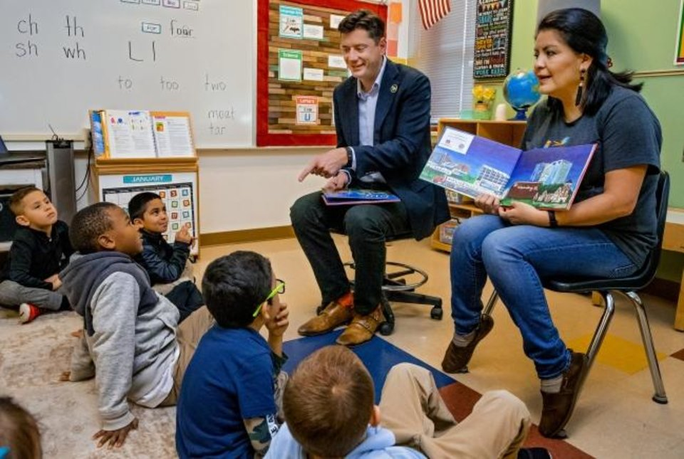 Photo -  Mayor David Holt and Oklahoma City School Board member Gloria Torres visit with students before they read the book 'Goodnight OKC' to Joscilyn Coleman's kindergarten class at Cesar Chavez Elementary in Oklahoma City, Okla Friday, Jan. 10, 2020.    [Chris Landsberger/The Oklahoman]