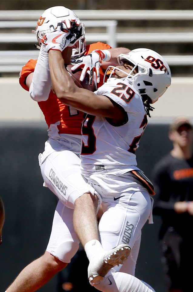 Photo - Oklahoma State's Bryce Brown (29) breaks up a pass for Oklahoma State's Dillon Stoner (17) during a 2-minute drill during the Oklahoma State Cowboys spring practice at Boone Pickens Stadium in Stillwater, Okla., Saturday, April 20, 2019.  Photo by Sarah Phipps, The Oklahoman