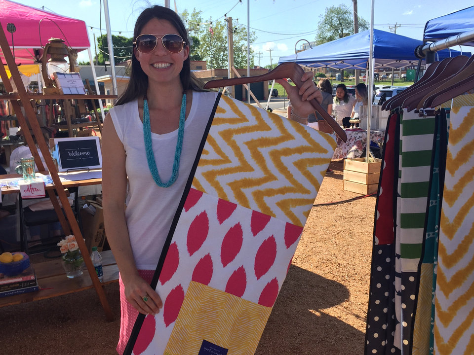 Photo -  Jennifer Andersen, owner of Sparrow Park Goods & Co., holds her signature item, a roll-up picnic blanket, at her booth at Industry Flea in Oklahoma City. Photo by Heather Warlick, The Oklahoman