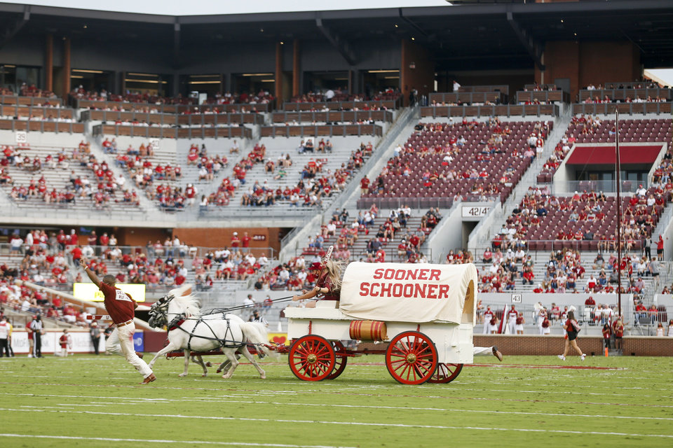 Photo - The Sooner Schooner runs onto the field after an OU touchdown during Saturday's game against Missouri State. IAN MAULE/Tulsa World