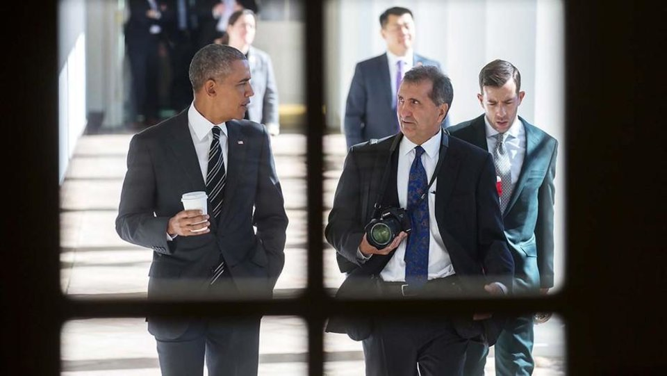 Photo - President Barack Obama, left, and former Chief White House Photographer Pete Souza are seen in the documentary