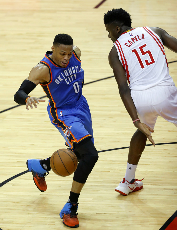 Photo - Oklahoma City's Russell Westbrook (0) goes around Houston's Clint Capela (15) during Game 2 in the first round of the NBA basketball playoffs between the Oklahoma City Thunder and the Houston Rockets at the Toyota Center in Houston, Texas,  Wednesday, April 19, 2017.  Photo by Sarah Phipps, The Oklahoman