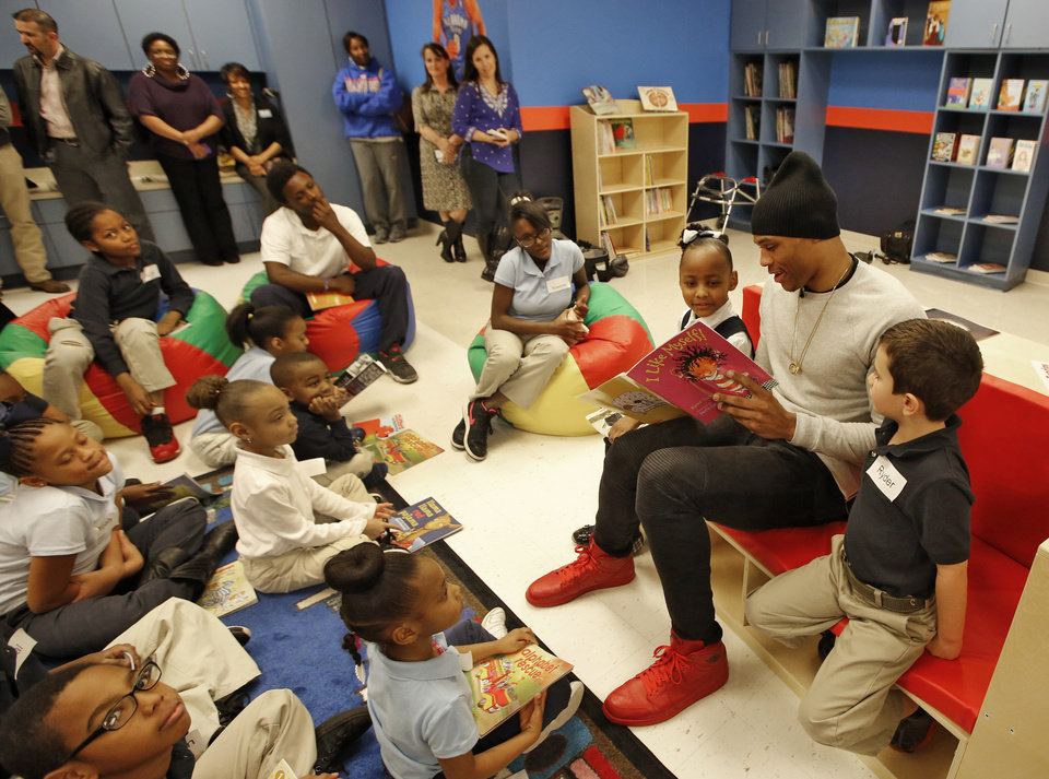 "Photo - Oklahoma City Thunder's Russell Westbrook reads ""I Like Myself!"" to students at Martin Luther King Elementary School during the opening of Russell's Reading Room in Oklahoma City, Monday February, 23 2015. Westbrook joined students and educators for the dedication of the new center. Photo By Steve Gooch, The Oklahoman"