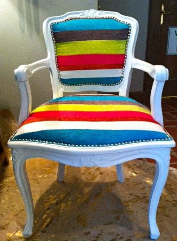 Photo - An old chair can gain new life with a fairly simple reupholstering and refinishing job. This chair was refurbished by Edmond interior designer Kellie Clements. Photo provided.