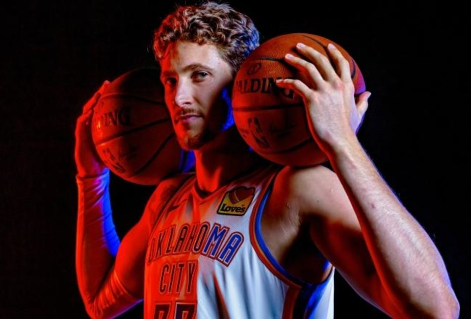 Photo -  Mike Muscala (33) poses for a photo during the Oklahoma City Thunder media day at the Chesapeake Energy Arena in Oklahoma City, Okla. on Monday, Sept. 30, 2019.  [Chris Landsberger/The Oklahoman]