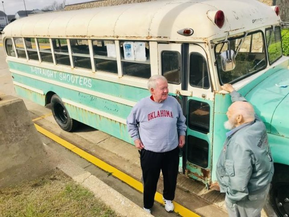 Photo -  Leigh Nichols and Ron Wheeler reminisce about the Straight Shooters youth ministry outside a vintage bus that the ministry used to transport them and other young people to church and different activities.  [Carla Hinton/The Oklahoman]