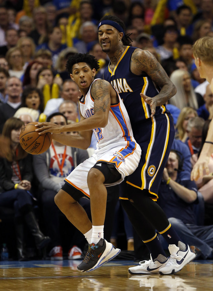 Photo - Oklahoma City Thunder's Cameron Payne (22) steals a pass intended for Indiana's Jordan Hill (27) in the second half of an NBA basketball game where the Oklahoma City Thunder lost to the Indiana Pacers 101-98 at the Chesapeake Energy Arena in Oklahoma City, on Feb. 19, 2016.  Photo by Steve Sisney The Oklahoman