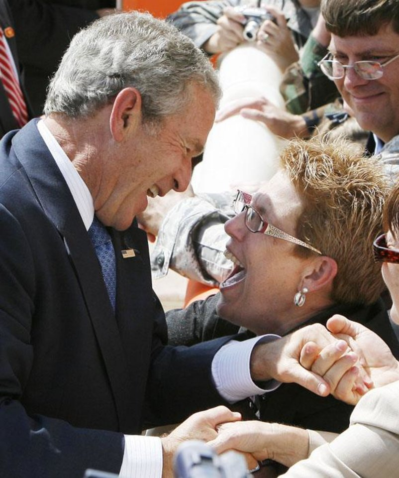 Photo -  OKLAHOMA CITY / STATE PRESIDENTIAL VISIT / SUPPORT / DEPARTURE / REPUBLICAN FUNDRAISER: President George W. Bush shares a laugh with a supporter, as he prepares to depart from Tinker Air Force Base in Midwest City, OK, after a brief trip to the state, Friday, Sept. 12, 2008. BY PAUL HELLSTERN, THE OKLAHOMAN ORG XMIT: KOD