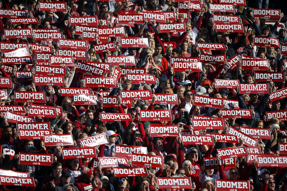 Photo -  OU fans display signs during a Bedlam college football game between the University of Oklahoma Sooners and the Oklahoma State University Cowboys. [File photo/The Oklahoman]