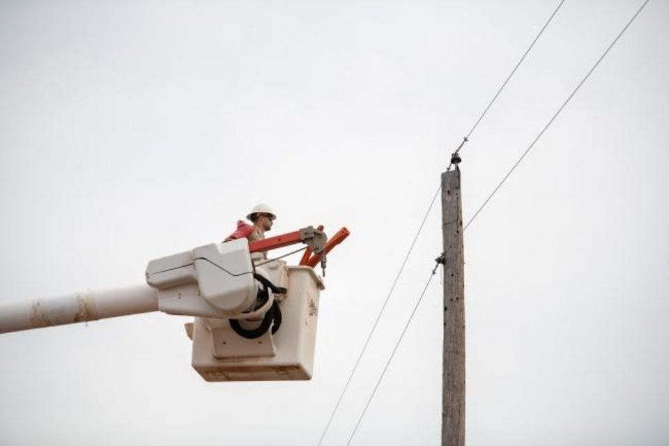 Photo -  A Central Electric lineman prepares to work on a single phase circuit within the cooperative's service territory. [PROVIDED BY CENTRAL ELECTRIC COOPERATIVE]
