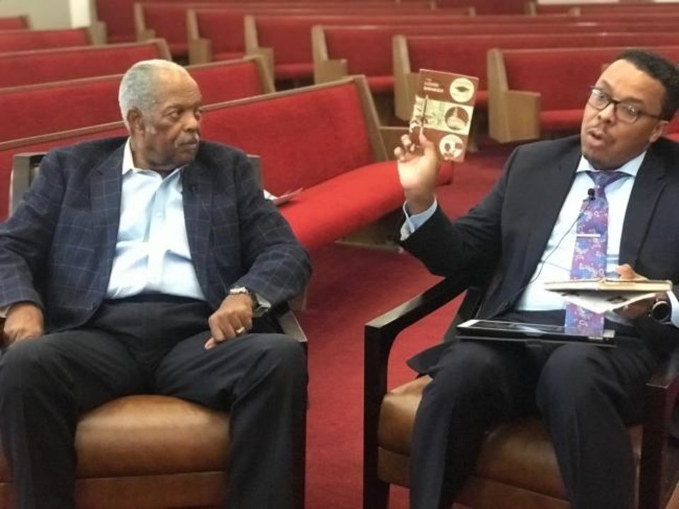 Photo -  The Rev. John A. Reed and the Rev. Derrick Scobey discuss the history of the Simultaneous Revival at Ebenezer Baptist Church, 3600 N Kelley, where Scobey is senior pastor. [Carla Hinton/The Oklahoman]