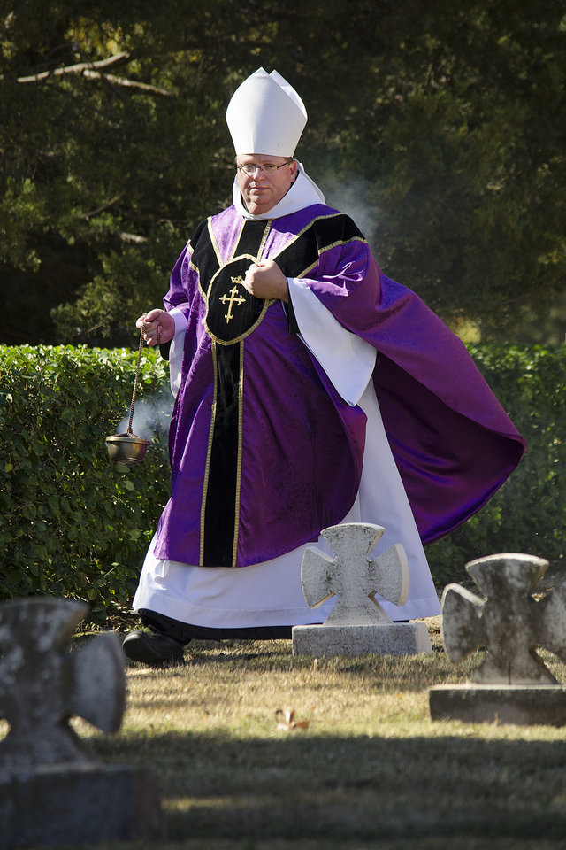Photo -  The Rev. Lawrence Stasyszen, abbot of St. Gregory's Abbey, performs a blessing in the abbey in Shawnee. [Photo by Theresa Bragg]