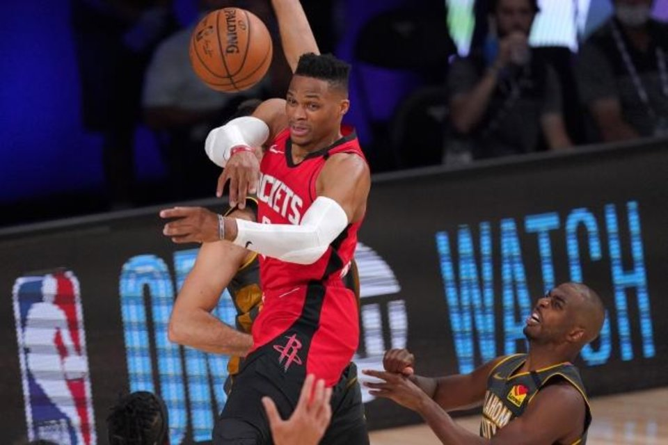 Photo -  Houston's Russell Westbrook (0) makes a pass as Oklahoma City's Chris Paul, bottom right, and others defend during the second half of Monday's Game 6. [AP Photo/Mark J. Terrill]