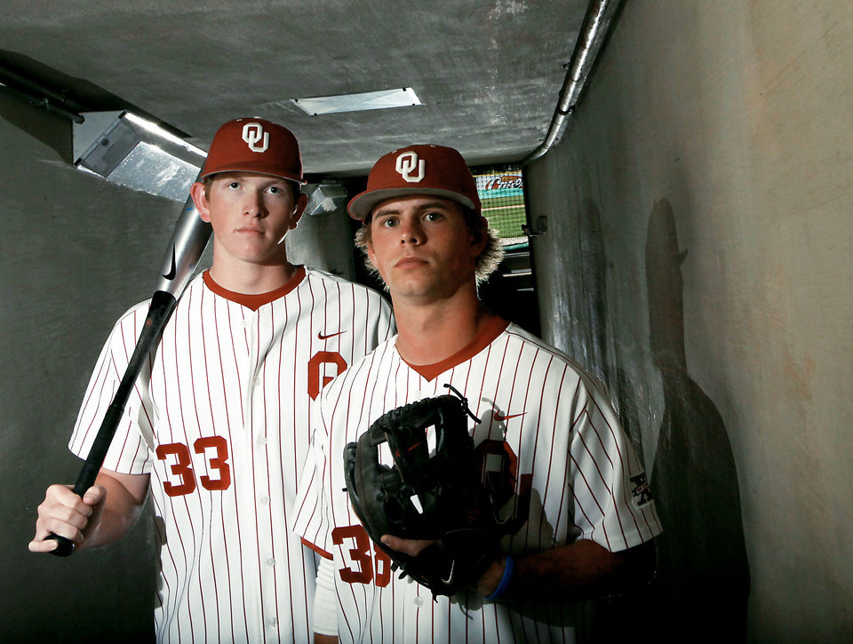 Photo - OU's Cameron Seitzer, left, was recently named the best defensive first baseman by Baseball America.  Photo by  John Clanton,  The Oklahoman Archive
