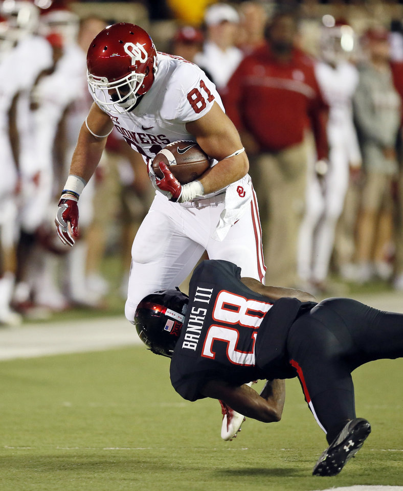 Photo - Texas Tech's Paul Banks III (28) tackles Oklahoma's Mark Andrews (81) in the second quarter during a college football game between the University of Oklahoma Sooners (OU) and Texas Tech Red Raiders at Jones AT&T Stadium in Lubbock, Texas, Saturday, Oct. 22, 2016. Photo by Nate Billings, The Oklahoman