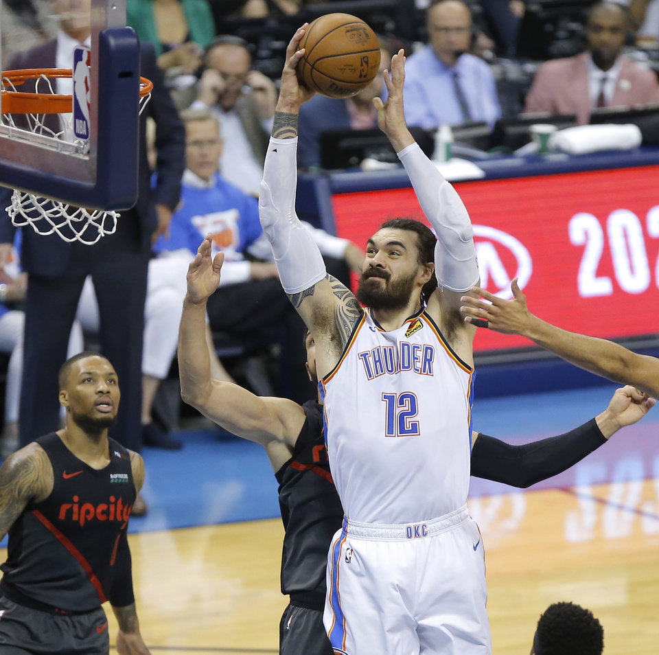 Photo - Oklahoma City's Steven Adams (12) goes to the basket during Game 4 in the first round of the NBA playoffs between the Portland Trail Blazers and the Oklahoma City Thunder at Chesapeake Energy Arena in Oklahoma City, Sunday, April 21, 2019. Photo by Bryan Terry, The Oklahoman
