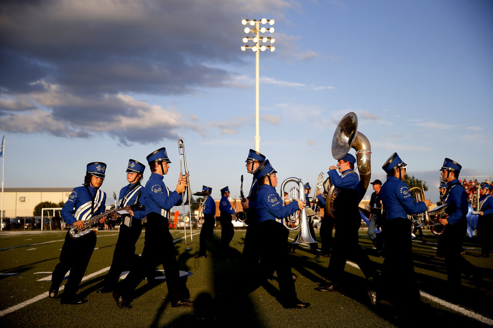 Photo - The Newcastle band performs before a high school football game between Newcastle and Blanchard in Newcastle, Okla., Thursday, Sept. 19, 2019. [Bryan Terry/The Oklahoman]