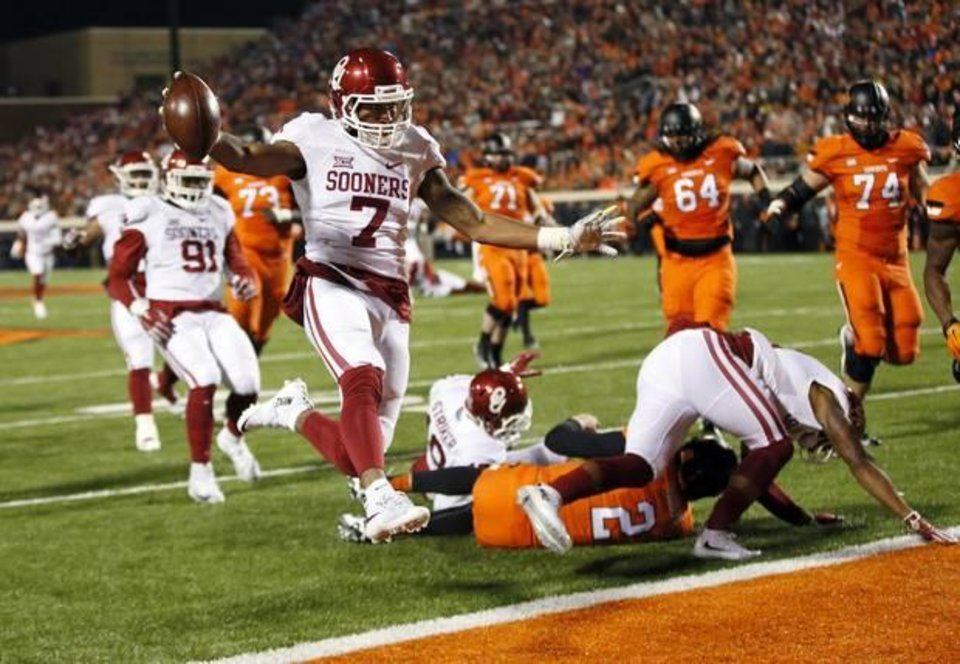 Photo - Oklahoma's Jordan Thomas (7) scores a touchdown after an interception in the second quarter during the Bedlam college football game between the Oklahoma State Cowboys (OSU) and the University of Oklahoma Sooners (OU) at Boone Pickens Stadium in Stillwater, Okla., Saturday, Nov. 28, 2015. Photo by Nate Billings, The Oklahoman
