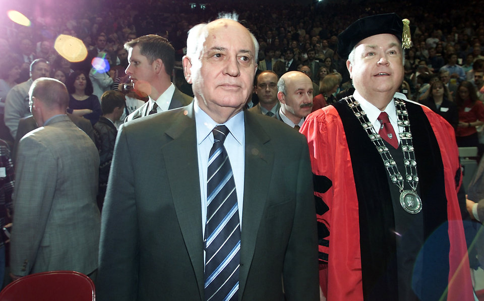 Photo - Former Soviet Premier Mikhail Gorbachev and OU President David Boren walk to the stage at the Lloyd Noble Center. Gorbachev's speech was on