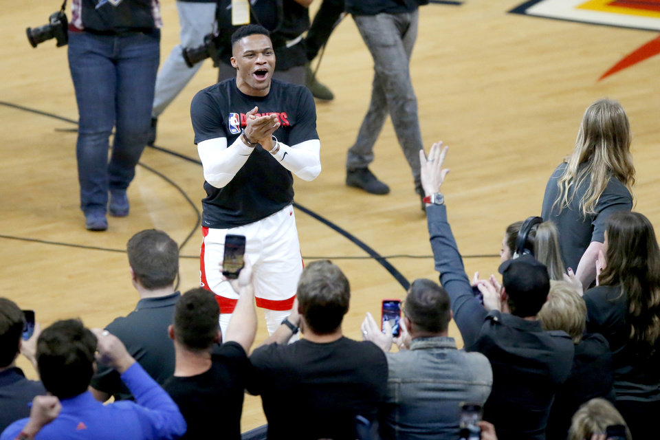 Photo - Houston's Russell Westbrook (0) acknowledges the crowd during introductions before an NBA basketball game between the Oklahoma City Thunder and Houston Rockets at Chesapeake Energy Arena in Oklahoma City, Thursday, Jan. 9, 2020. [Bryan Terry/The Oklahoman]