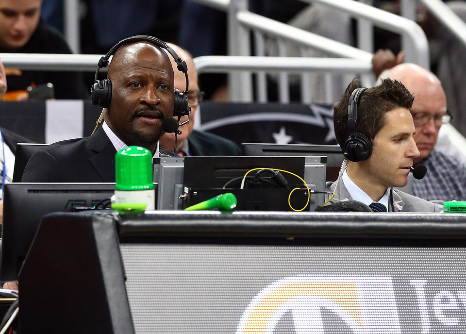 Photo -  Thunder TV announcers Michael Cage and Chris Fisher call an OKC game at Orlando in January. The duo will call road games remotely this season from OKC due to the coronavirus pandemic. [Kim Klement/USA TODAY Sports]